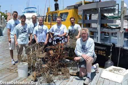 2012-05-31 Backyard Cleanup Campaign, on the dock in front of the <em>Clearwater</em>. The hardworking volunteer crew of ODA (left to right): Andy The, Shingo Ishida, Steve Millington, Phil Koehler, Peter Fulks, Billy Arcila, and Captain Kurt Lieber. More debris removed from the oceans means cleaner, safer habitat for marine wildlife!