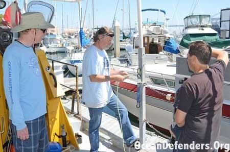 Onboard the <em>Clearwater</em> in dock: Jeff Connor, Jim Lieber, and Billy Arcila learning how to tie knots.