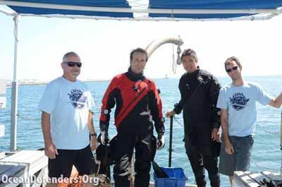 Some of ODA's finest! John Krieger, Steve Millington, Andy The, and Graham Futerfas before the first dive. Notice the LA Harbor lighthouse in the background – that's where we went to do our cleanup work.