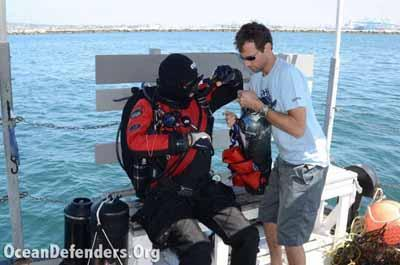 Graham Futerfas helps Steve Millington secure his stage bottle (this is what the divers us to fill the lift bags used to float the debris to the surface).