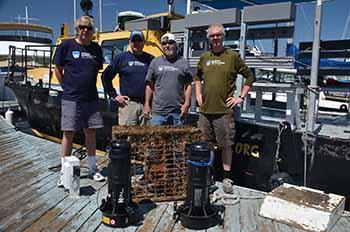 "Ocean Defenders Alliance Dive & Boat Crew with their ""prize"": Kurt Lieber, Al Laubenstein, Jeff Connor, and Jim Lieber"