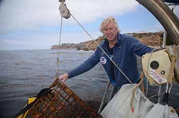 Ocean Defenders Alliance Founder Kurt Lieber hauling trap