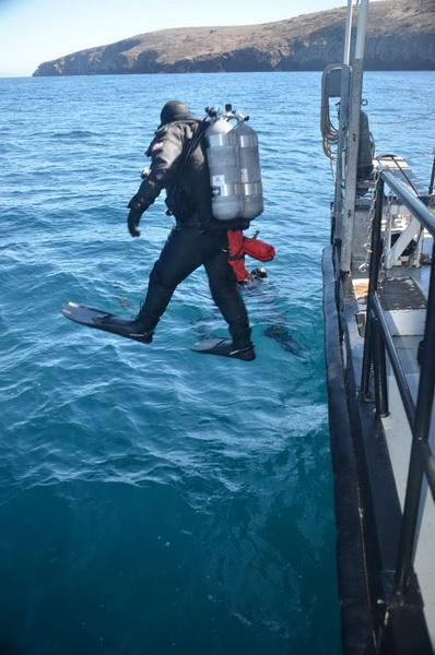 Volunteer Dive Crewmember Trevor Fulks jumping in