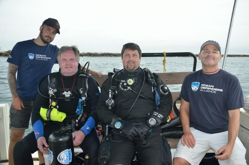 ODA Boat Crew Adam Fram and Rex Levi with dive-gear-outfitted Al Laubenstein & Jeff Larsen