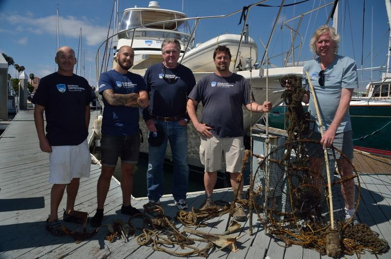 ODA Dive & Boat Crew with the days catch - marine debris including a lobster hoop net
