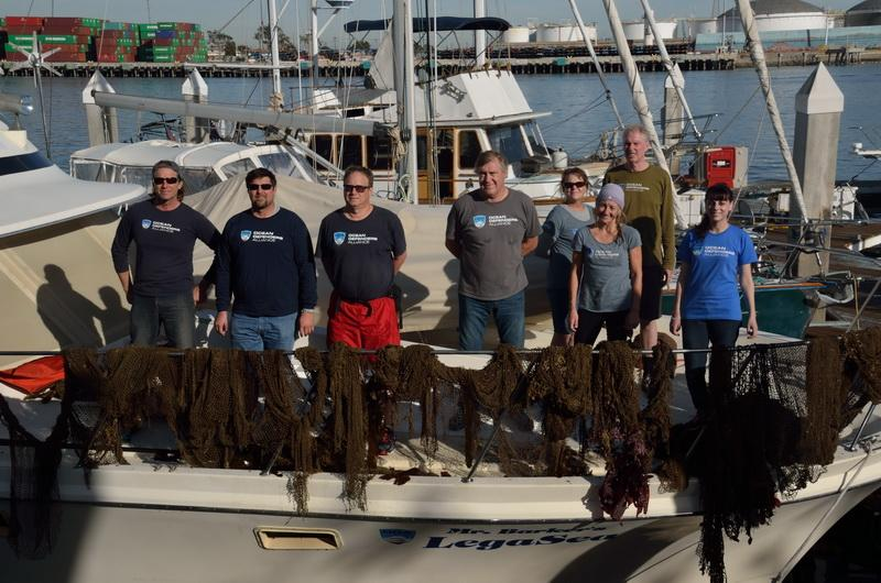 The entire ocean conservation crew with marine debris removed