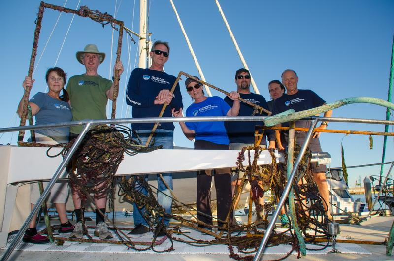 Ocean Defenders Dive and Boat Crew happily display recovered lobster trap lines and remnants
