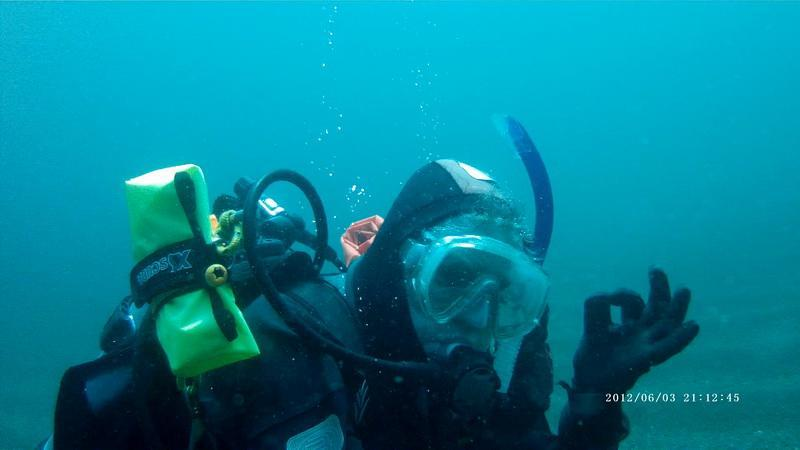 ODA SCUBA Diver removes ghost gear
