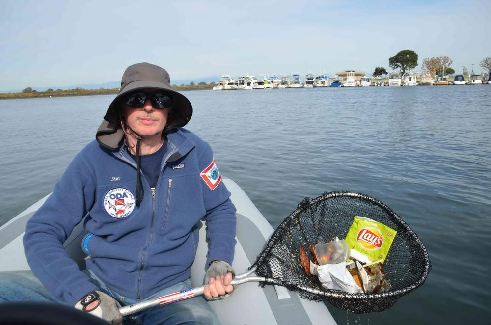 ODA volunteer cleans survace waters