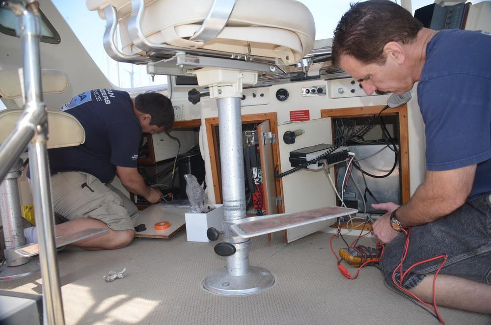 Jeff and Kevin Augarten - jacks of all trades! Working on the boat's electronics.