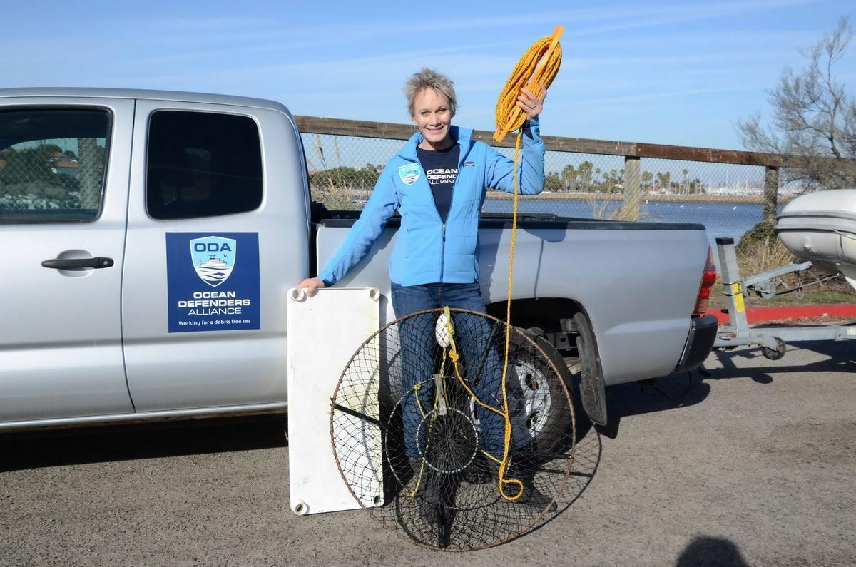 ODA volunteer Linda and hoop trap removed from ocean